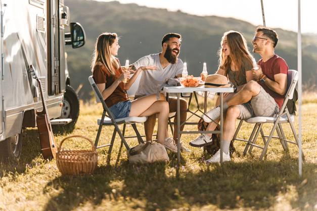 Friends gathering outside of the camper van